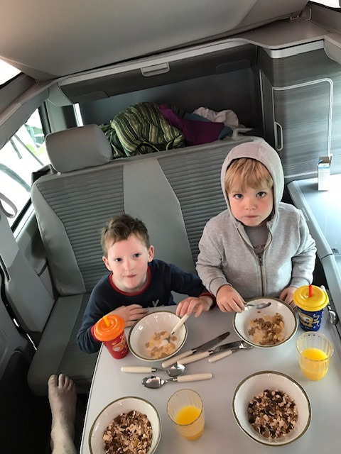 Kids having breakfast in the Campervan